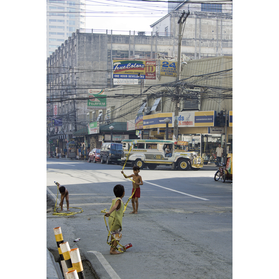children playing, street, traffic, Manila, Philippines