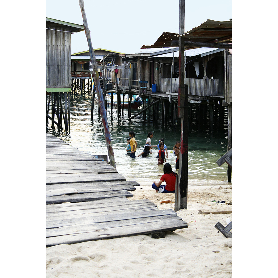 village, children swimming, Mabul, Borneo, Malaysia
